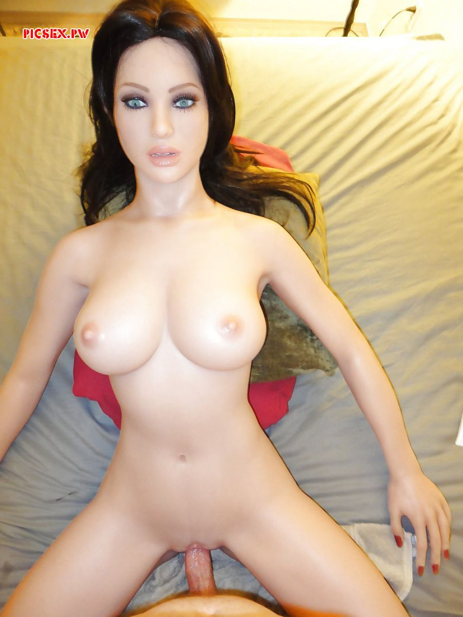planted dick in a rubber doll with perky Tits