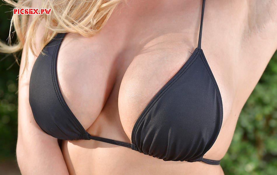 a woman's breast in swimsuit close