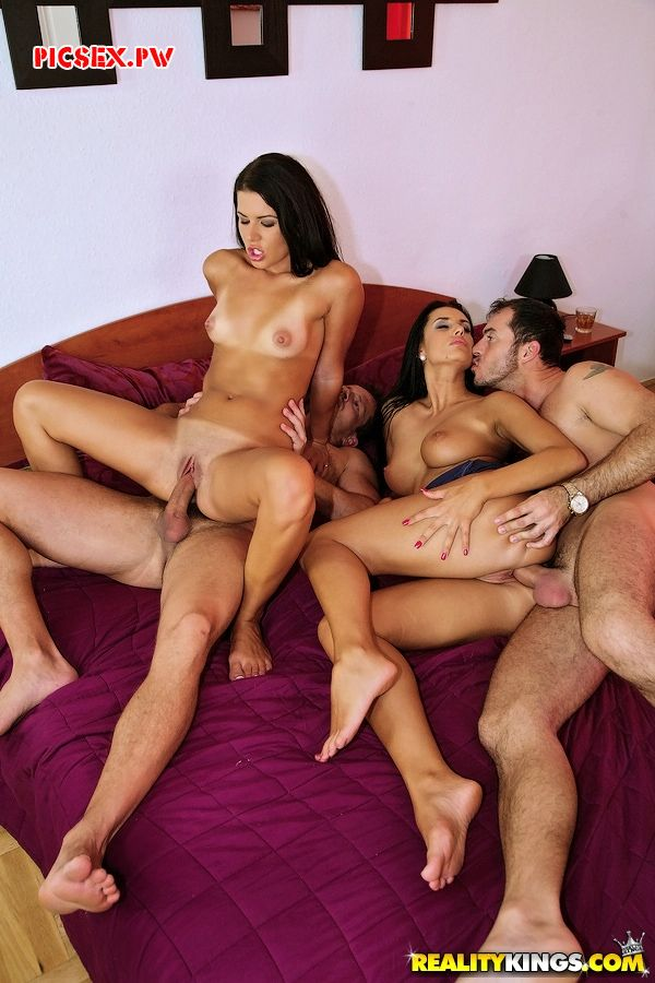 beautiful brunette engaged in group sex Swingers