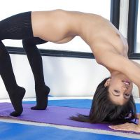 brunette gymnast makes the workout
