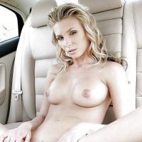 naked gorgeous blonde in an expensive car