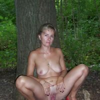 naked woman with a big pussy in the woods