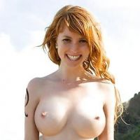 red-haired young woman with large natural Breasts