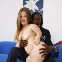 a naked midget with a black man