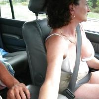 babuska is masturbating the penis of her husband in the car